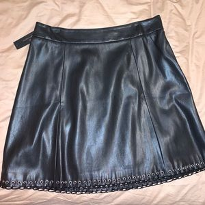 Faux leather grommet skirt